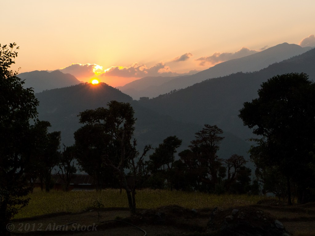 A cloudy sunset over Karmi Danda's fields.