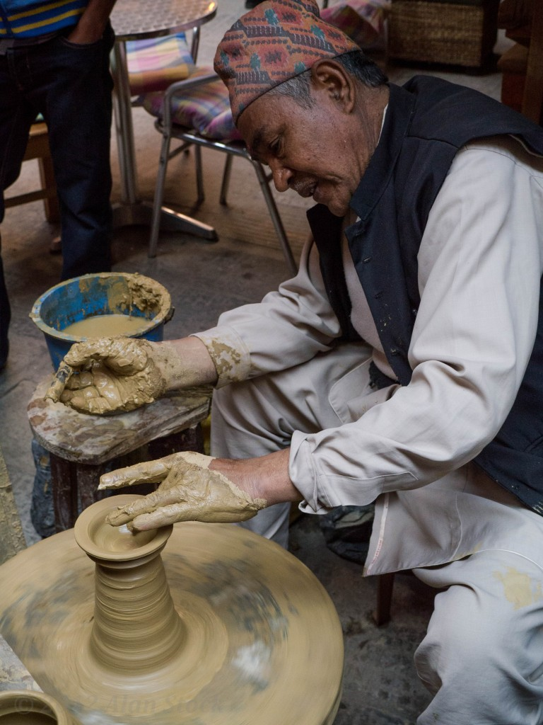 Traditional potter at work at the street festival