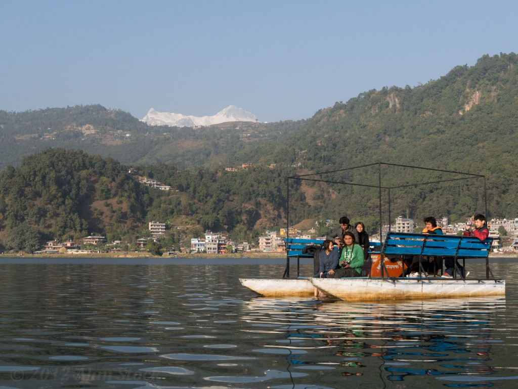 Tourists explore Phewa lake a pedal boat