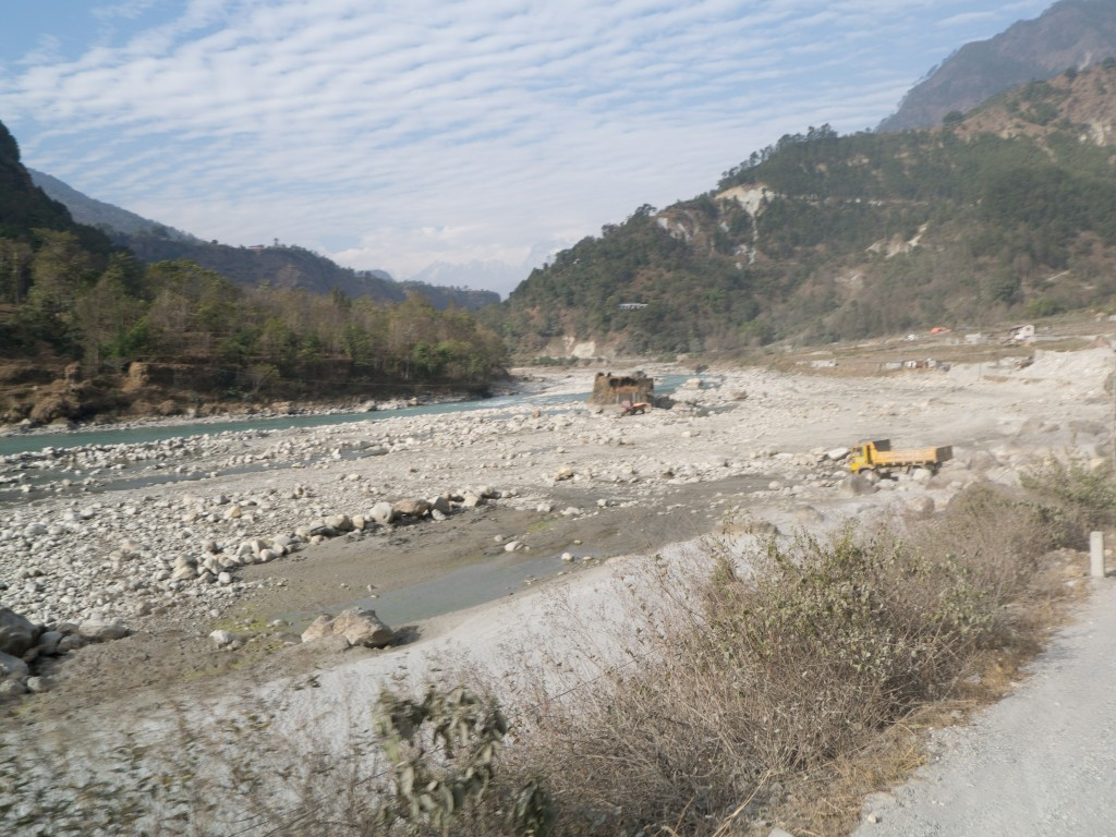 In Nepal you often see trucks and tractors down by the rivers with people filling them up with rocks