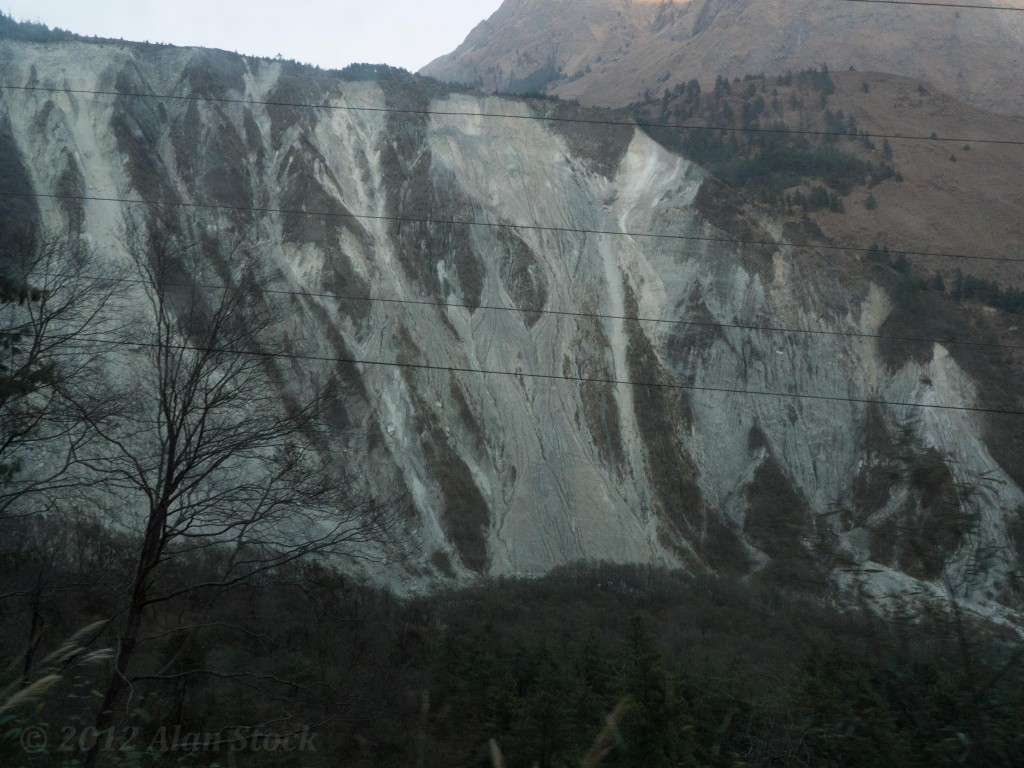 Huge landslides cover the  hillside. It's hard to convey the sheer scale of them here.