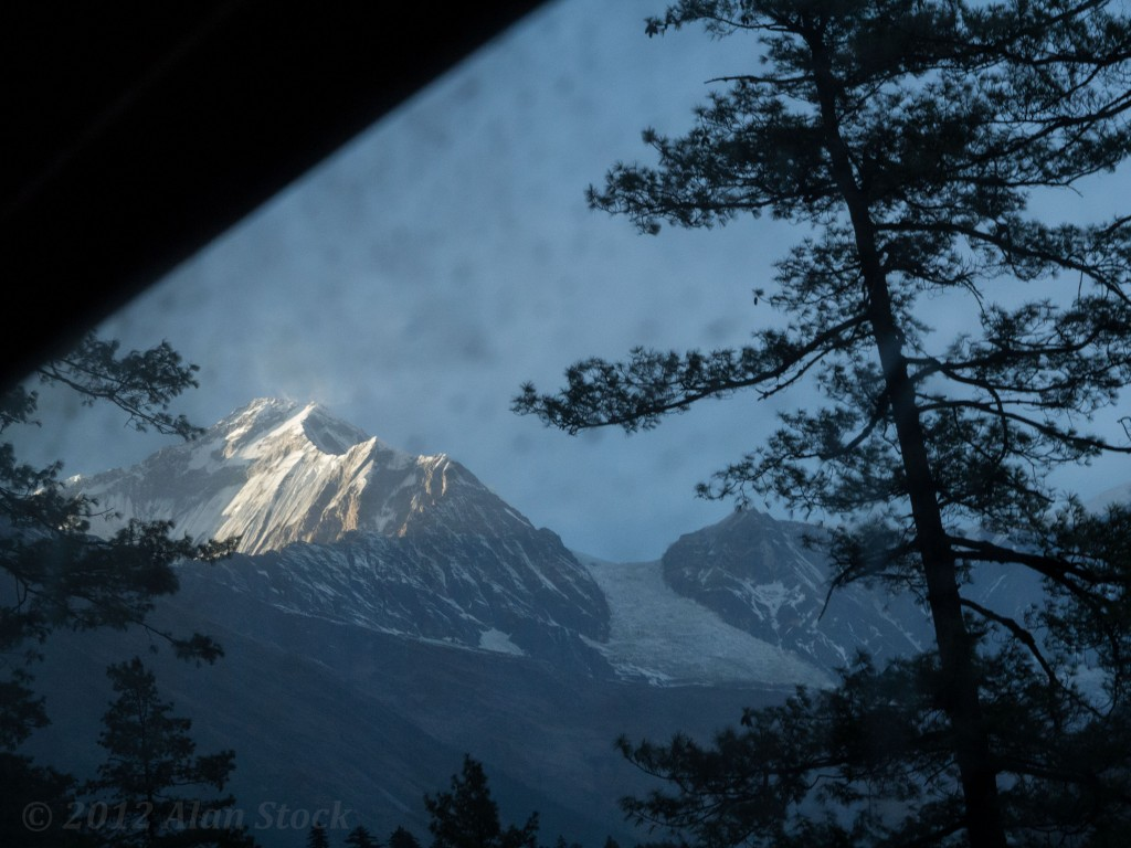 The last sun reflects off the snow covered Himalaya above us