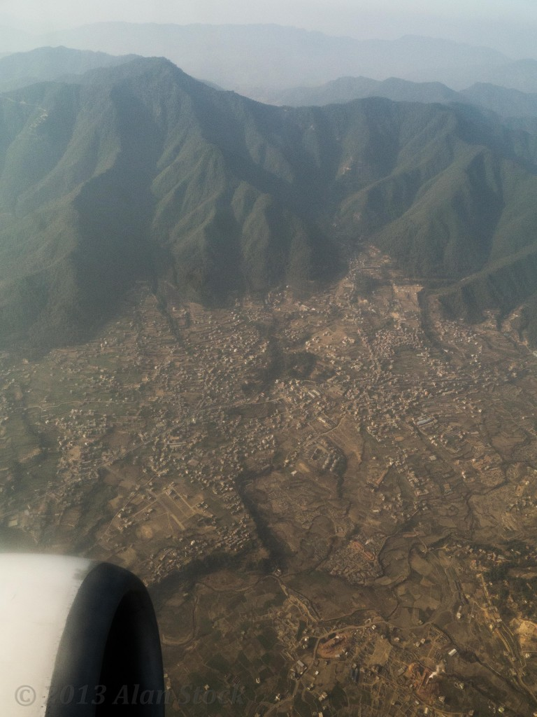 Looking out over a Nepali town as as I fly towards India